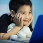 Kid on computer dollar photo
