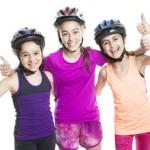 Girls with bike helmets